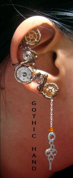 """Awesome steampunky ear cuffs!"" Looks like ear is weighted down. Would add more supporting grips somewhere."