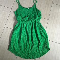 Green lace like dress Such a beautiful green dress. Elastic at waist with adjustable straps with lace like fabric and lining underneath.  this is a must have for any time of year!! Wear with flip-flops or wedges dress it up with a cute pair of heels even. You can even wear this with leggings. This dress is like new. Xhilaration Dresses Midi