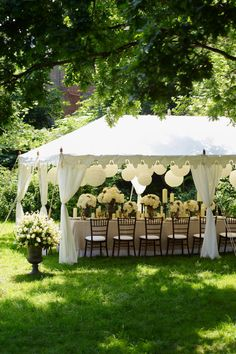 Wedding tent pavilion with flowers and balloon lantern decor