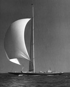 The spinnaker on Endeavour II balloons out with the wind during a New York Yacht Club cruise. Endeavour II was commissioned by T.O.M Sopwith for the sole purpose of becoming a challenger in the 1937 America's Cup races. From the Edwin Levick Collection.