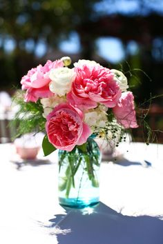 Love how the pink daisies and white roses look in aqua mason jar