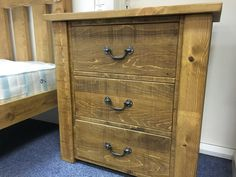 Large Rustic plank bedside chest with drop handles. Made to order by www.cobwebsfurniture.co.uk
