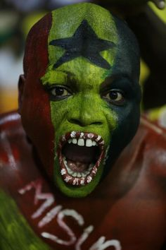 http://www.blackstarsquare.com/ A Ghana soccer team supporter painted in Ghana flag chants before their their African Cup of Nations Semifinals soccer match with Equatorial Guinea at Estadio De Malabo, Equatorial Guinea, Thursday Feb. 5, 2015. (AP Photo/Sunday Alamba)