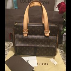 "Louis Vuitton LV Multipli-Cite bag w receipt! Authentic, great condition, has minor scuffs, red lining is in excellent condition. I have dust bag, and can include receipt for whenever you're ready to re-sell!  Reasonable offers only.  Shoulder strap 7.5, H 12"", W 14"", Depth 4.5"". I don't trade unless you're willing to send your luxury item first. If truly interested use Offer option. Offers in comments will be ignored. Price firm on posh 😉 Louis Vuitton Bags"