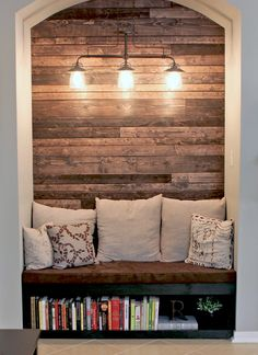 Cozy reading nook with wood plank wall. All it needs is a window with a nice view.
