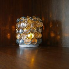 Pin for Later: 221 Upcycling Ideas That Will Blow Your Mind Glass Jar Night Light Stick glass beads on a glass jar and insert a battery votive to create a cute night light. Here's how. Photo: Sarah Lipoff