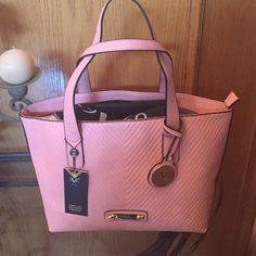 Versace Sportivo Tote in Salmon/Coral Colour Really pretty Salmon Colour Tote from Versace. Has gold hang tags an a dust bag. Roomy inside with two open pockets and one zippered pocket. Fabric lined. Versace Bags Totes