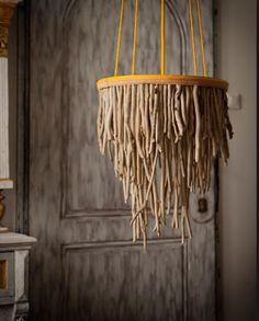 I'm thinking-- take this idea, but make it a WORM chandelier for the haunted house! :: This is a chandelier crafted from driftwood makes a stunning focal point. Driftwood Chandelier, Chandelier Lighting, Chandeliers, Hanging Chandelier, Beach Crafts, Diy Crafts, Rope Lamp, Driftwood Projects, Wood Lamps