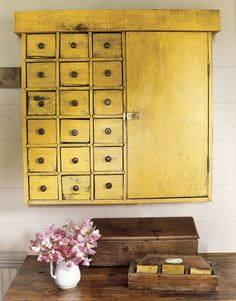 """add a burst of color to a bathroom (with) a small storage cupboard with original mustard paint upside down and mounted it on the wall."""" photo credit: Thayer Allyson Gowdy via Country Living Read more: Decorating with Texan Antiques - Country Painted Furniture, Diy Furniture, Refinished Furniture, Distressed Furniture, Recycled Furniture, Vintage Furniture, Furniture Dolly, Cabinet Furniture, Yellow Cupboards"""