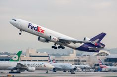 FedEx MD-11F, N575FE, blasting away from LAX on January 18, 2017