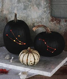 Bring the night sky to your front porch with constellation pumpkins.