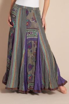 Vintage Peruvian artwork inspired this exotic crinkled cotton & rayon skirt that shimmers with metallic highlights and sways with vivid purple embroidered godets among the floral and striped panels. Decorative ribbon accents the hem.