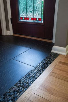 Transitioning from a wood floor into a tile foyer can sometimes be too blunt. With this project we added a glass mosaic tile allowing an awesome transition to flow from one material to the other.