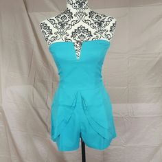 """Tea & Cup Blue Strapless Romper So cute! Size Medium. Strapless Yellow romper by Tea & Cup. Front skirted overlay. Slit pockets on the sides and back. Back zipper. There is a very slight stretch to it but not much. Price firm unless bundled!   Measurements (laying flat)  Bust-15""""  Waist-14"""" Hips-18""""  I have a Hot Pink (M) and a Yellow (M) also available in separate listings! Tea n Cup Dresses Mini"""