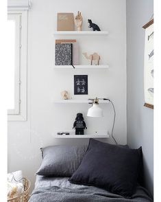 I like the colors here, but I'm not too sure that those high shelves will be at all functional or safe!