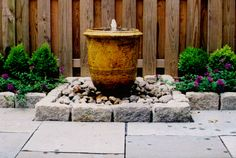 urn water feature | urn fountain granite cobble edging creates a niche for this urn ...