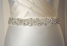 Fabulous blingy belt! Embellishment goes all the way around your waist! Belts are stitched on ribbon, closes with metallic hooks and eyes.