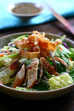 Chinese Chicken Salad - This classic east meets west salad can be found at classy joints like Wolfgang Puck's or Madam Wu's but why pay through the nose for a dish so simple you can toss up as much as you want in the comfort of your own kitchen, especially since the dressing is vinaigrette-based and can keep longer in the fridge than mayonnaise-based dressings.
