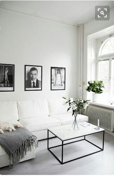 Minimalistic living room ideas // black and white interior // hanging framed photos wall decoration