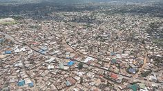Aerial photography of the city of Dar Es Salaam showing the densely packed houses and buildings Dar Es Salaam, Long Exposure, Urban Landscape, Aerial Photography, Landscape Photographers, Hdr, Beautiful Landscapes, City Photo, Most Beautiful