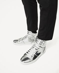 Zara SILVER HIGH-TOP SNEAKERS. 30 June 2017 on sale was $69.90, now 49.99. Plain silver high-top sneakers with laces. Quilted at the ankle with white sole.