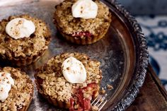 Apple & Rhubarb Crumble Tarts - Served with rich cream or on their own, these warm apple and rhubarb tarts are perfect winter fare.