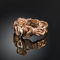 """High-polished solid rose gold ladies classic Irish Claddagh Ring with celtic trinity band.  Band width: 5.8mm (0.22"""") Claddagh emblem height: 12.8mm (0.5"""")  Available in 10k & 14k gold.  Made in USA."""