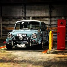 Another beautiful car in blue! From your car is amazing! - Love the spotlights. Mini Cooper Classic, Mini Cooper S, Classic Mini, Minis, Vintage Racing, Vintage Cars, Aston Martin Dbs, Mini Morris, Automobile