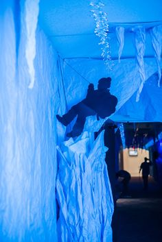 Climber silhouettes decorate an ice cave hallway at #OperationArctic #vbs2017