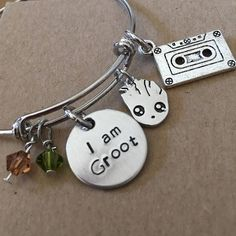 Show your love of all things Groot with this adjustable bracelet complete hand-stamped aluminum charm, Groot charm, mix tape, and green and brown Swavorski crystals. Bracelet is adjustable. There are two choices for size. The medium size is 8 inches in diameter and stretches to 8 3/4