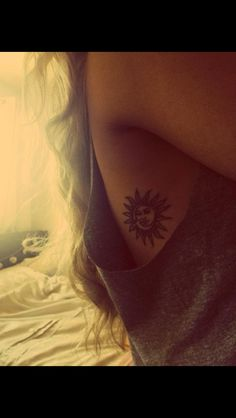 sun and moon rib tattoo.. seriously love this one, reminds me of my mom