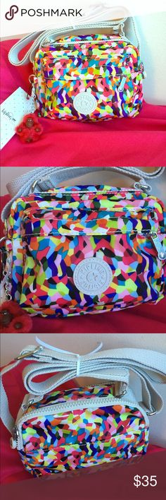 NWT Kipling crossbody bag Super colorful and fun mini bag. Has lots of pockets for storage but is compact so you can travel light. Just adorable! Kipling Bags Crossbody Bags