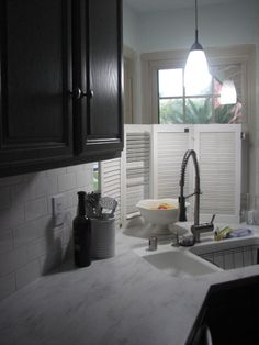 Schon Raincloud Corian Countertops With A White Subway Backsplash, And Gray  Cabinets. Kitchen Remodel.