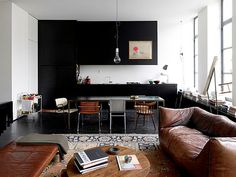 via door sixteen: black cabinets, photo by frederik vercruysse