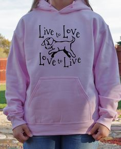 A playful pup with only two things in mind, living and loving.  Original design on quality shirts.