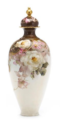 Franz Arthur Bischoff (American, 1864-1929) Vase with cover with pink and white roses and scroll work  signed 'Franz A Bischoff' (on the shoulder) porcelain with raised enamel and gilt height: 15 3/4in