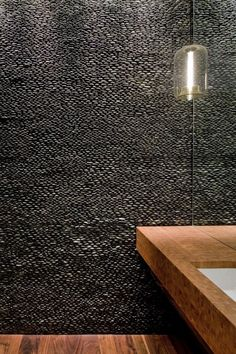 pebble wall in master where headboard would be, rest of walls same color or lighter grey