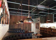 Seating area Industrial Cafe, Industrial Restaurant, Industrial Lighting, Painting Contractors, Building Contractors, Restaurant Entrance, Cafe Restaurant, Entrance Lighting, Ceiling Grid