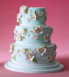 Rolled fondant cake with Japanese anemone-inspired sugar flowers. By Confetti Cakes. Via www.brides.com.