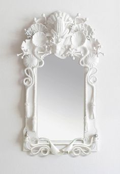 Codor Design mirrors. Layer found items then coat with plaster or white paint. Maybe something for 3D Printer Chat?