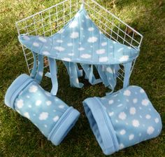 Guinea pig tunnel with cuddly fleece and reinforced opening -- Clouds  Size: Medium (for guinea pigs, larger hedgehogs, ferrets, smaller dwarf bunnies, and other similarly sized small animals)    This handmade fleece guinea pig tunnel is made with a blue