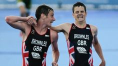 An exhausted Jonny Brownlee is helped over the finish line by elder brother…