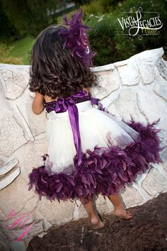 SO CUTE!! Sew a feather boa to a tutu. Flower girl!