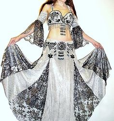 Professional belly dance costume with silver lace and gothic style brooches. Model: Sofia Metal Queen / Sofia Goldberg of Ameynra.