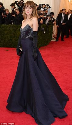 Leading the glamour: Kim Kardashian (L) and Dakota Johnson wore blue gowns to the Met Gala in New York on Monday