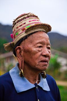 The old Kelabit man wears the traditional headwear and still sports the long ears which are characteristic of this tribe..