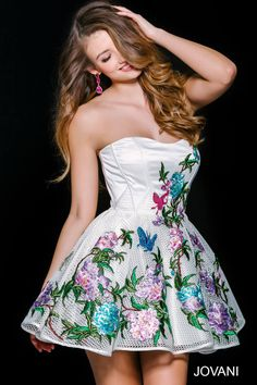 This white #jovani 41386 embroidered floral dress is perfect for the flower child.