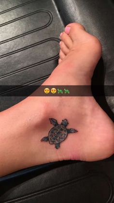 Turquoise small turtle foot tattoo