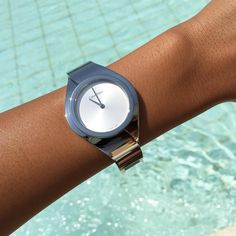 Blogger Nadia Mneimne cools down poolside, wearing the Senses watch in silver from Calvin Klein Watches + Jewelry. #ckminute