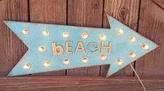 Cute little BEACH arrow, sand detail on letters.  Marquee details: - Great vintage looking bulbs - Constructed of quality birch wood or reclaimed planks and pieced together with great care - Uses regular 120v power with an 8 cord and an inline rocker switch - Yes, the 5 watt bulbs (plus 3 extras) are included - D-ring hanger on the back - Can be used inside or out! We recommend a patio or eave covering for outdoor use.   Our products are handmade with great care so please allow 3 - 4 weeks…